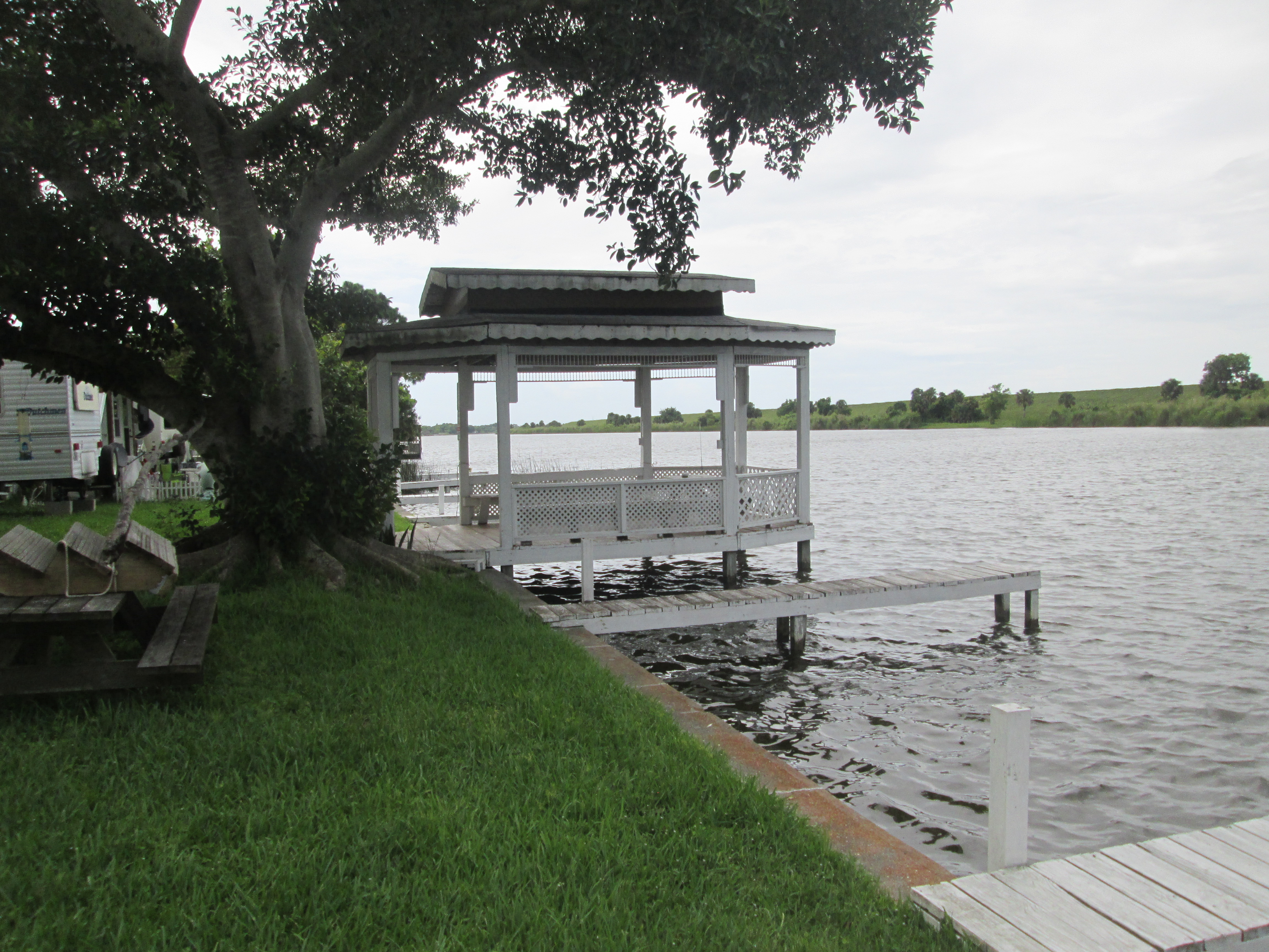 Sit & relax at the picnic tables on the charming gazebo on the docks at the tiny house village in Florida